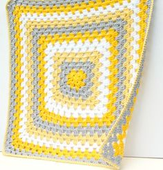 Yellow Baby Blanket: It's just a huge granny square, using my favorite granny square pattern. 20 rounds of 2 rows of color. Then single crocheted all around the blanket with in each corner. The finished blanket measures about 22 inches square. Crochet Unique, Love Crochet, Single Crochet, Knit Crochet, Chevron Crochet, Crotchet, Easy Crochet, Motifs Granny Square, Granny Square Blanket