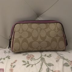Coach makeup bag Great condition, only used a few times, a few graphite marks on inside lining (used as pencil case), authentic, tan exterior with lilac trim Coach Bags Cosmetic Bags & Cases