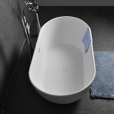 Oval Shape 64 Inch Freestanding Matte White Stone Resin Soaking Bathtub with Overflow and Center Drain Soaking Bathtubs, Living Environment, Smooth Lines, Cast Stone, White Stone, Modern Luxury, Oval Shape, Resin, Shapes