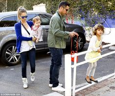 Honor looked more content to balance on a railing than to walk with her parents