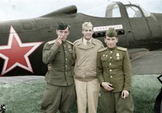 Operation Frantic Andrea Hincerockur a Russian pilot, Lt. Thompson Highfill of the 99th Bomb Ground and Corzen Venzopkin another Russia Pilot, pose behind a Soviet P-39.