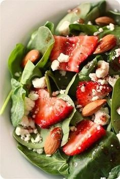 spinach, strawberry and goat cheese salad with pomegranate vinaigrette >>...no almonds for me but still good.