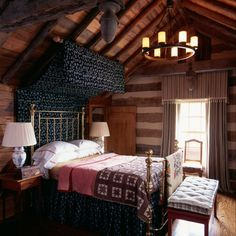 Ah, Grandma's old homestead, compete with handmade quilts and a brass bed. And yet it's not country cute, is it? It's both elegant and comfortable.  by Johnson Berman