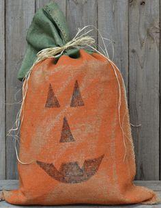 For Halloween: a burlap sack painted & stuffed into a jack o' lantern!