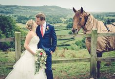 Not only does this wedding photograph from Cranberries Luxury Hideaway have the most scenic views as their background, but it also has a stunning country horse looking over the newly married couple. This is a perfect shot from what was obviously a perfect country garden wedding.