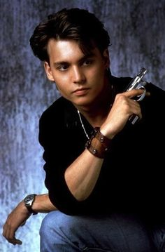 That time he posed seductively with a small gun | Johnny Depp's Awesomely Bizarre Photo Past