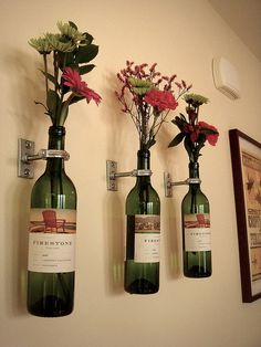Find nicer looking clamps to hang bottles or spray paint and conceal with grape vine swag.