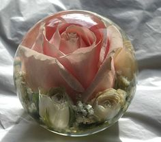 Omg! Preserve your wedding day flowers in a beautiful paperweight to keep forever :)