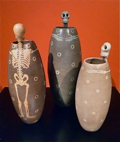 """Calaca Vases<br />burnished clay<br />Michoacan<br />19 1/2"""" high,  SOLD<br />17 1/2' high,  $195.00<br />14 1/2"""" high,  SOLD"""