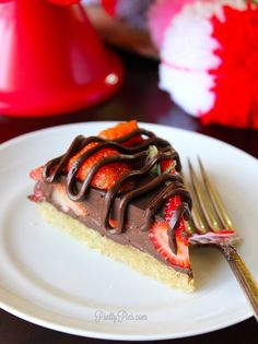 Perfect for Valentine's Day: Chocolate Covered Strawberry Pie! An elegant dessert bursting with juicy berries in a decadent chocolate ganache-- without any gluten, grains, dairy, or eggs. (Vegan and Paleo friendly) Love is in the air Can you feel it? It's officially February and that means Valen