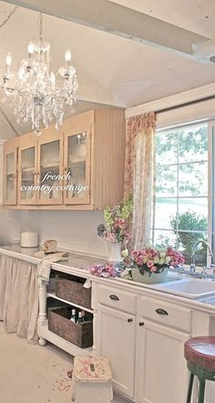 All Things Shabby and Beautiful I like the combination of cupboards and curtains.