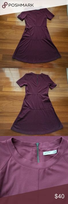 Athleta En Route Dress in Chianti Worn only a few times and in great condition. Viscose/nylon spandex blend, very stretchy. Machine wash and dry. Athleta Dresses