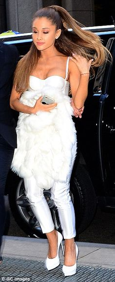 Feeling pure: Ariana Grande arrived in an all-white ensemble consisting of cropped trousers, a bustier, platform heels and a fur jacket