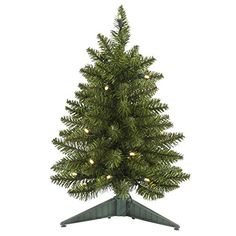 18 PreLit Battery Operated Artificial Christmas Pine Tree  Warm Clear LED Lights *** You can find out more details at the link of the image.