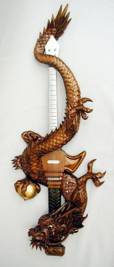 Traditional wood-carved guitars prove Japan is the most metal Holzschnitzen – Holzbearbeitung Unique Guitars, Custom Guitars, Power Metal, Mayor Tom, Heavy Metal, Mundo Musical, Rock Y Metal, Guitar Notes, Bass Guitar Lessons