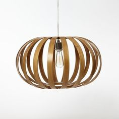 I love the earthy-meets-modern feel of this wooden pendant. It feels substantial and airy all at that same time.