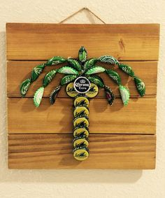 This Florida Inspired Palm Tree is a fun and unique addition to any beach or fun in the sun themed room! Made from bottle caps adhered to finished wood. Comes ready to hang This Florida Inspired Palm Tree is a fun and unique addition to any beach or Bottle Top Crafts, Bottle Cap Projects, Diy Bottle, Beer Cap Art, Beer Bottle Caps, Bottle Cap Art, Bottle Cap Table, Beer Cap Crafts, Wine Cork Crafts