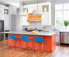 Bold Kitchen Island A red-orange island makes a big impact in this white kitchen. Cool blue stools add a fun contrast to the bold island. Don't be afraid to create strong contrast between the island and its surroundings. Kitchen Remodel Pictures, Galley Kitchen Remodel, New Kitchen, Kitchen Decor, Kitchen Design, 1950s Kitchen, Ranch Kitchen, Narrow Kitchen, Kitchen Ideas