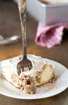Cinnamon Roll Poke Cake Recipe - this cake and frosting are unreal! It's one of the best cakes I've ever made!