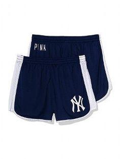 New York Yankees shorts, white v neck and a Yankees baseball cap!!