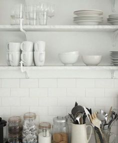 Simple and functional kitchen shelving. Love the mason jars, too!