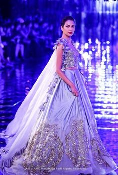 All roads led to Taj Palace yesterday because Manish Malhotra unveiled his 2017 couture collection amongst a set of mirrors, black paper roses and a metallic ramp. We actually got a chance to go backs. Indian Wedding Gowns, Indian Dresses, Indian Outfits, Indian Designer Outfits, Designer Dresses, Couple Wedding Dress, Wedding Outfits, Choli Dress, Lehenga Skirt