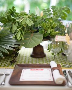 a tropical wedding table setting with local foliage instead of flowers #wedding