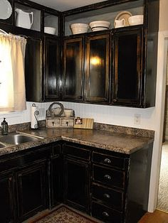 Kitchen Makeover:  I looked for months for the 'perfect' black, distressed cabinets...then I found this post this spring. Perfect! My cabinets are finally painted & just need some distressing.