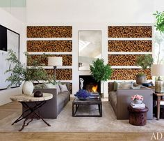 Patrick Dempsey's Malibu living room features a wall of built-in shelving for firewood and a pair of custom-made sofas.