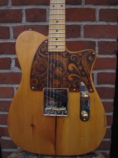 Bowery Pine Kellecaster with wood burned pick guard by Kelly. Kellyguitars.com