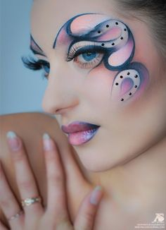 Artistic purple and pink fantasy make-up with crystal accents.