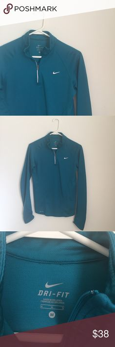 NWOT Nike Dri-Fit Running Top Never worn and in perfect condition. Truest to color is the last picture, but it's more green in person. It's a true turquoise color. The sleeves have pockets at the bottom perfect for holding keys and a few dollars. * PRICE IS FIRM. NO TRADES * Nike Tops