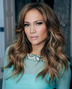 Jennifer Lopez has perfected her look with big, cascading volumized waves. It's the ultimate bombshell style with a soft touch.
