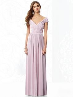Dessy Collection Bridesmaids Style 6697 Full length cap sleeve maracaine jersey dress w/ draped bodice and sweetheart neckline. Slightly shirred skirt.