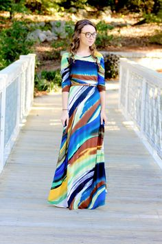 Sahara is a classy water color style maxi dress with 3/4 sleeves and modest neckline