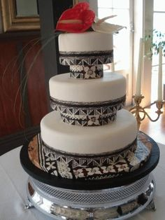 Tapa/Masi wedding cake - follow my board - http://www.pinterest.com/kirsteenlawrenc/my-perfect-wedding-in-fiji/