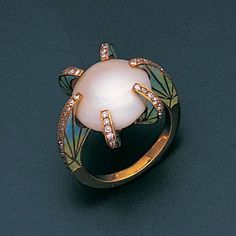 A pearl, enamel and diamond ring The central bouton pearl within a six-claw setting, each millegrain-set with single-cut diamonds, the shank and shoulders enamelled with stylised foliate motifs, two claws are hinged