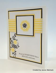 Very elegant with ribbon, layering of papers, stamped flowers, and pop of small 3D flowers.