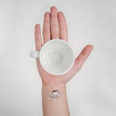 Tattly made a flat white (coffee line) tattoo. The best.  DESIGNED BY  JULIA ROTHMAN  Brooklyn, New York  NAME  COFFEE  PRICE  $5 (Set of 2)