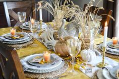 The tablescape I created for Thanksgiving this year was inspired by a recent ad by Pier 1 Imports (yes, again!) which included shades of o. Thanksgiving Table Settings, Thanksgiving Tablescapes, Thanksgiving Decorations, Small Pumpkins, White Pumpkins, Wheat Centerpieces, Square Glass Vase, Grace Home, Grey Runner