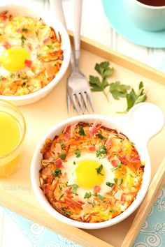 This easy baked eggs recipe cooked inside a bowl of cheesy hash browns topped with bacon and fresh herbs will your new favorite breakfast or brunch for lazy weekend mornings.