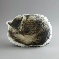 """Sleeping Cat Pillow now featured on Fab. in the seamPillows Inspired By Urban Life  Ronda J Smith of in the seam mines the streets of major cities for inspiration for her pillows. Her fine art photographs capture every aspect of the concrete jungle—from manhole covers to iconic yellow cabs—and are printed onto cozy cushions handmade in Brooklyn for locals and long distance admirers who """"heart"""" NY"""