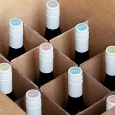 See how this brand used fun colors and small stickers to brand the top of their wine bottles.