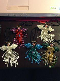 Handmade Angel ornament / keychain. $5.00, via Etsy.