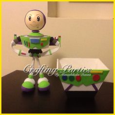 Buzz Lightyear from Toy Story Handmade fofucha doll and matching wood base. Wood base decorated with foamy and acrylic paint. Doll Stands 30cm tall. Made out of E.V.A. Foam & styrofoam material. For price information or to see more of my creations, visit me on facebook at www.facebook.com/CraftingPartiesByDianna or on Instagram @craftingparties