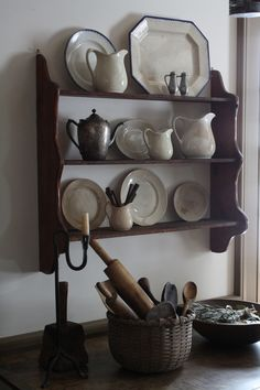 Ironstone crockery display. Nice idea to mix it with old pewter.