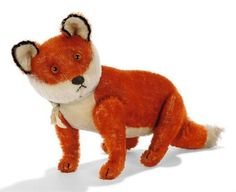 A STEIFF MOHAIR JOINTED FOX, (5317), dark orange and white, brown and black glass eyes, black stitching, black mohair trim to ears, swivel head, inoperative squeaker and FF button in ear, circa 1912 --11in. (28cm.) long (slight thinning)