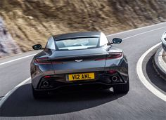 The worst-kept automotive secret of the year, Aston Martin's long-awaited has been officially revealed at the Geneva Motor Show. Our first glimpse of Aston's 'Second Century' plan, it's the illustrious company's most significant car since the arrived in Fast Sports Cars, Super Sport Cars, Super Cars, Fast Cars, Aston Martin Db11, Aston Martin Vanquish, Automobile, Bond Cars, Car Badges