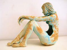 Thoughtful figure by Faye Mayo Ceramics