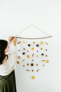 diy holiday wall hanging with dried oranges, walnuts, pinecones, cinnamon sticks, and star anise - Holiday Bohemian Christmas, Natural Christmas, Scandinavian Christmas, Simple Christmas, Winter Christmas, Christmas Home, Christmas Crafts, Xmas, Navidad Simple